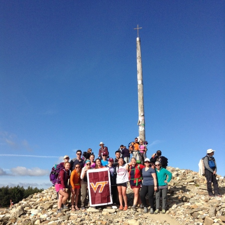The group standing at the highest point of the Camino